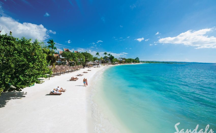 the beach with sandals negril in the background in negril jamaica