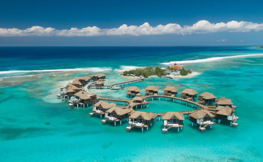 an ariel view of the over the water cabanas at sandals royal caribbean