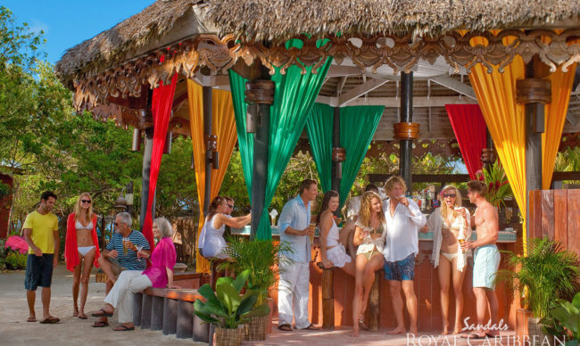 beach bar with guests at sandals resorts