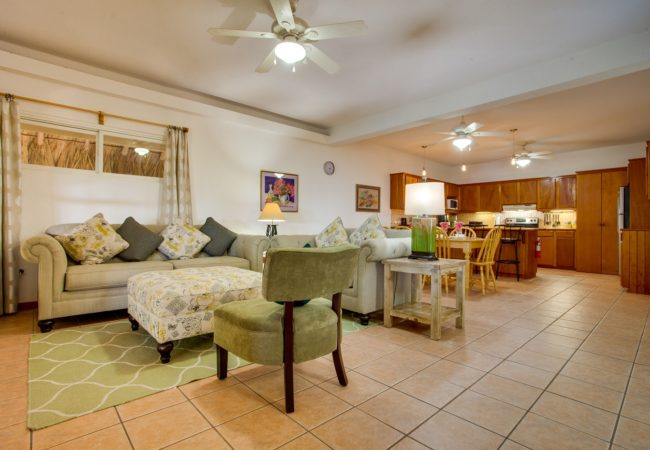 living room, dining room and kitchen in the villas at xanadu belize on the island of ambergris caye