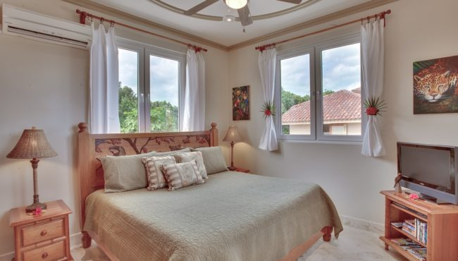 one off the bedroom at the luxurious villa solemar at belizean cove estate