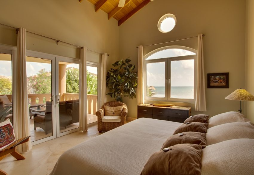 an oceanfront bedroom at the luxurious villa watina at beliezan cove estate on the island of ambergris caye belize
