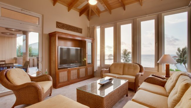 villa del mar living room overlooking the caribbean sea at belizean cove estate belize