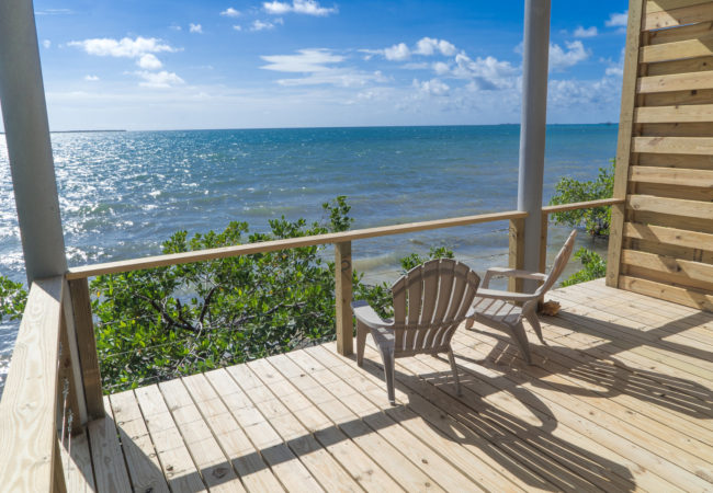 Oceanfront Cabanas overlooking the caribbean sea at thatch caye island resort belize