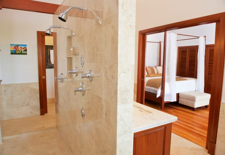 a look from the bathroom into the master suite at san ignacio resort hotel belize