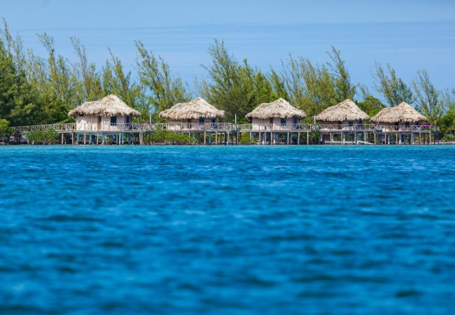 over the water cabanas at thatch caye private island belize