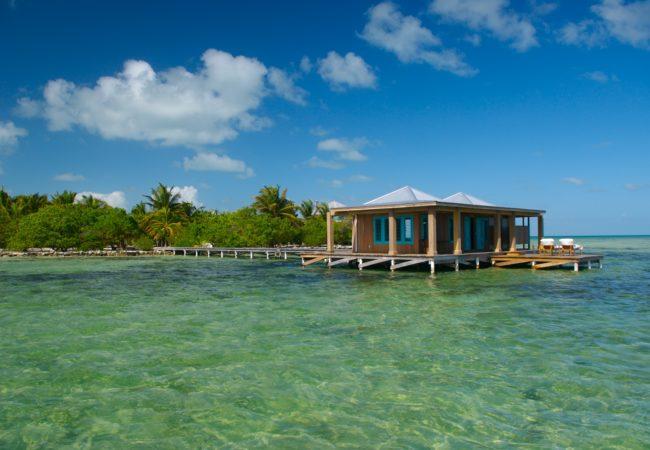 casa ventanas over the water room at cayo espanto island resort belize