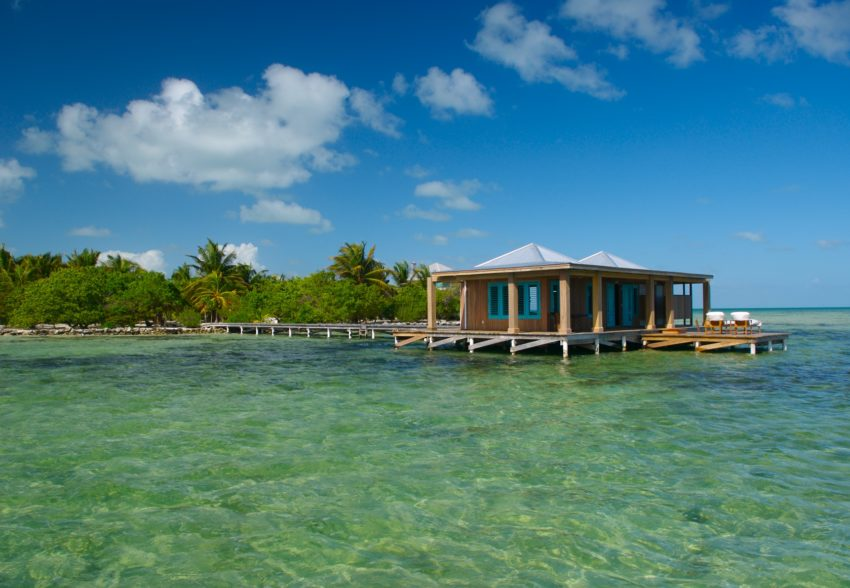 casa ventanas over the water room at cayo espanto island resort belize