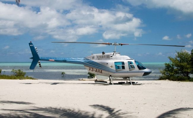 belize helicopters on the beach waiting for clients