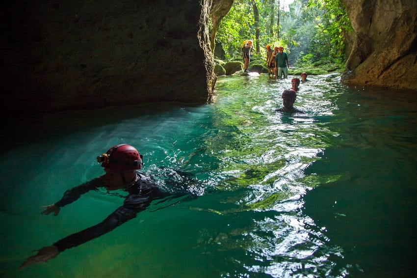 guests swimming in the belize atm cave