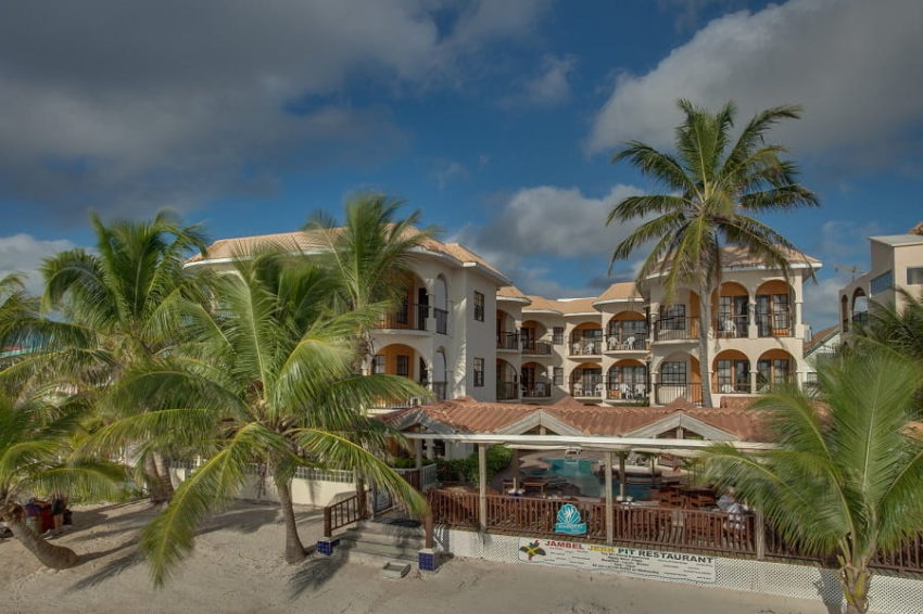 front view of the restaurant and hotel of sunbreeze suite on the island of ambergris caye belize