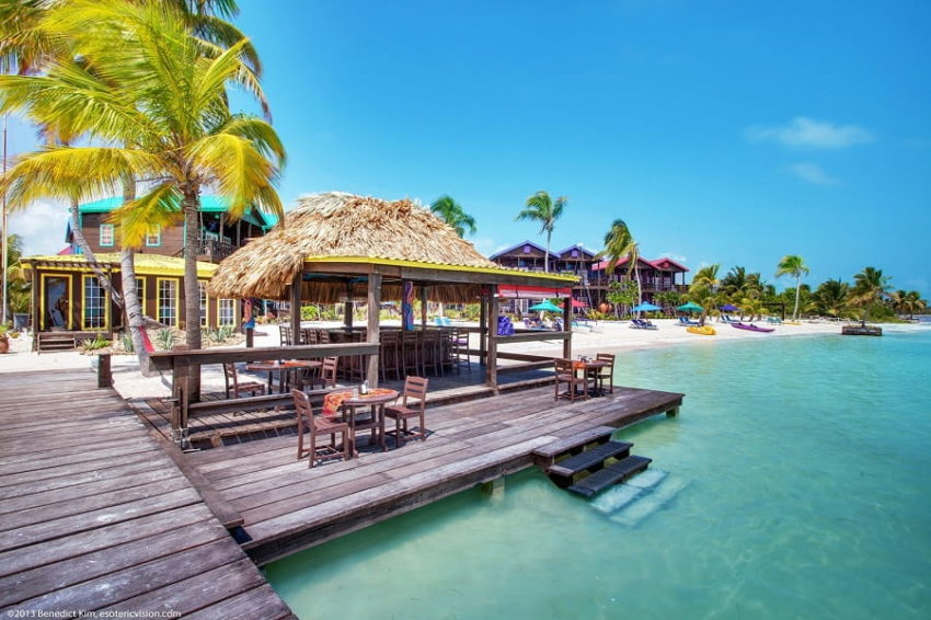 view of the over the water bar and beach at xtan ha resort on ambergris caye in belize