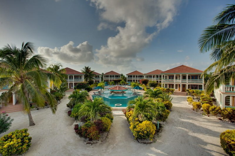 accommodations surrounding the main pool with pool swim up bar at belizean shores resort on the island of ambergris caye