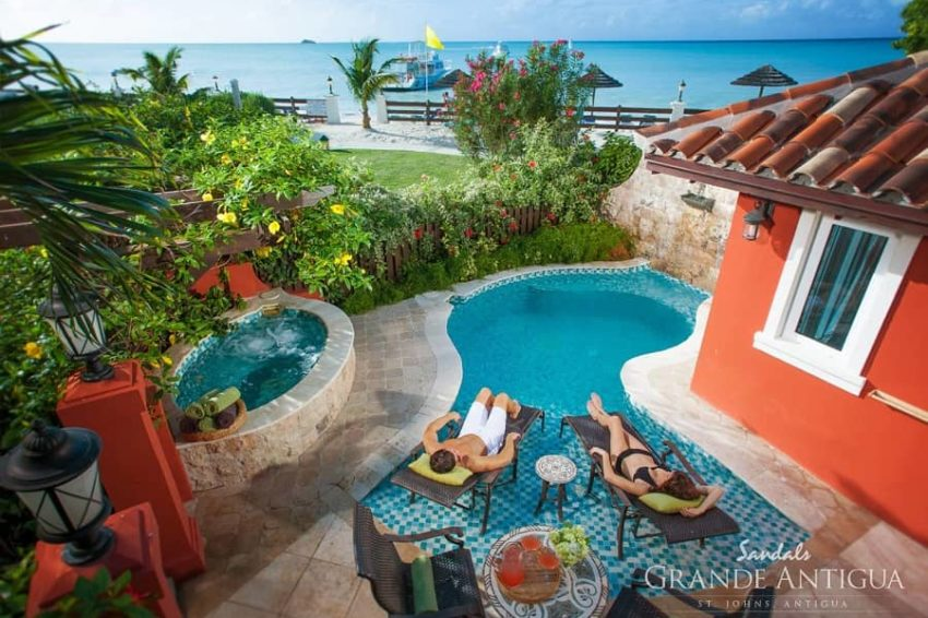 guests relaxing at the private pool of the Mediterranean One Bedroom Butler Villa with Private Pool Sanctuary room at sandals antigua