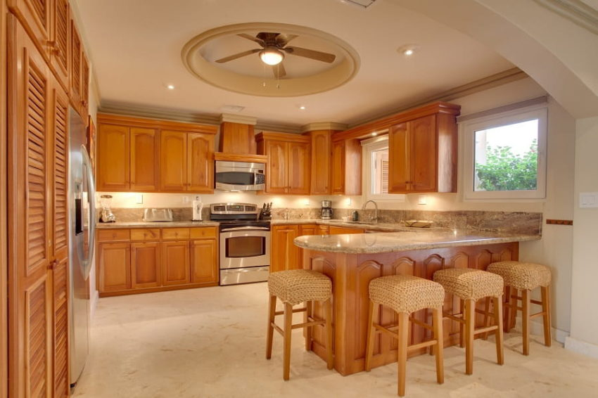 the kitchen with breakfast bar in the brushstrokes villa at belizean cove estates