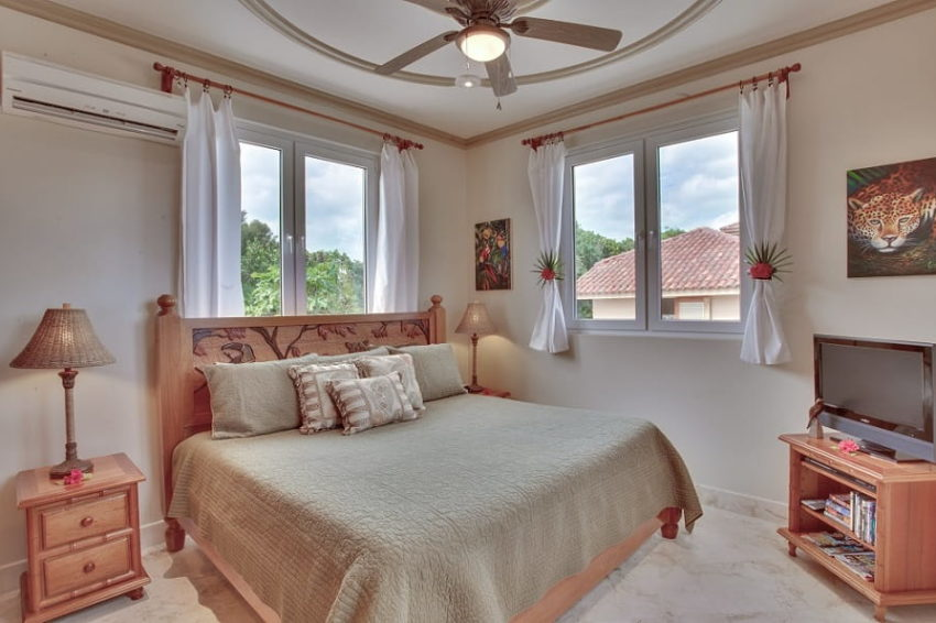 one of the bedroom with king bed and window that overlook the natural surroundings at villa solemar