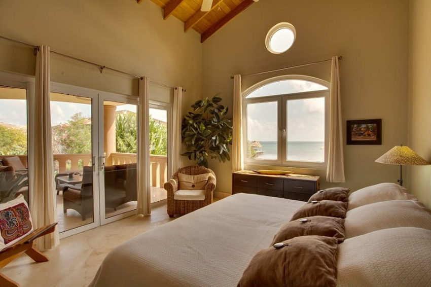 the master bedroom featuring a private balcony overlooking the caribbean sea
